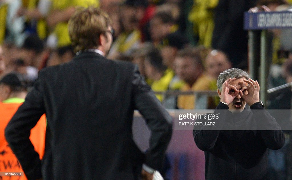 CROP - Dortmund's head coach Juergen Klopp (L) looks on as Real Madrid's Portuguese coach Jose Mourinho (R) gestures during the UEFA Champions League semi final first leg football match between Borussia Dortmund and Real Madrid on April 24, 2013 in Dortmund, western Germany. Dortmund won the match 4-1.