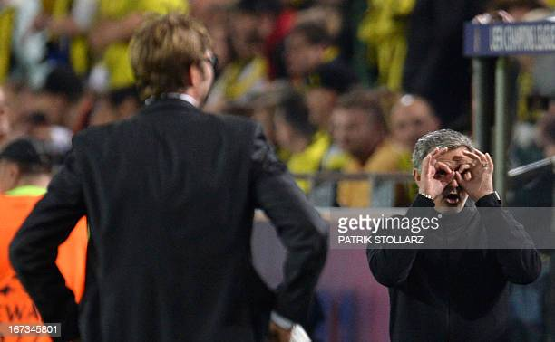 CROP Dortmund's head coach Juergen Klopp looks on as Real Madrid's Portuguese coach Jose Mourinho gestures during the UEFA Champions League semi...