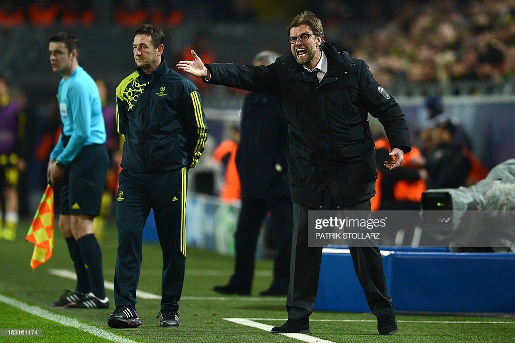 Dortmund's head coach Juergen Klopp (R) reacts during the UEFA Champions League last 16, second leg match Borussia Dortmund vs Shakhtar Donetsk in Dortmund, western Germany, on March 5, 2013.