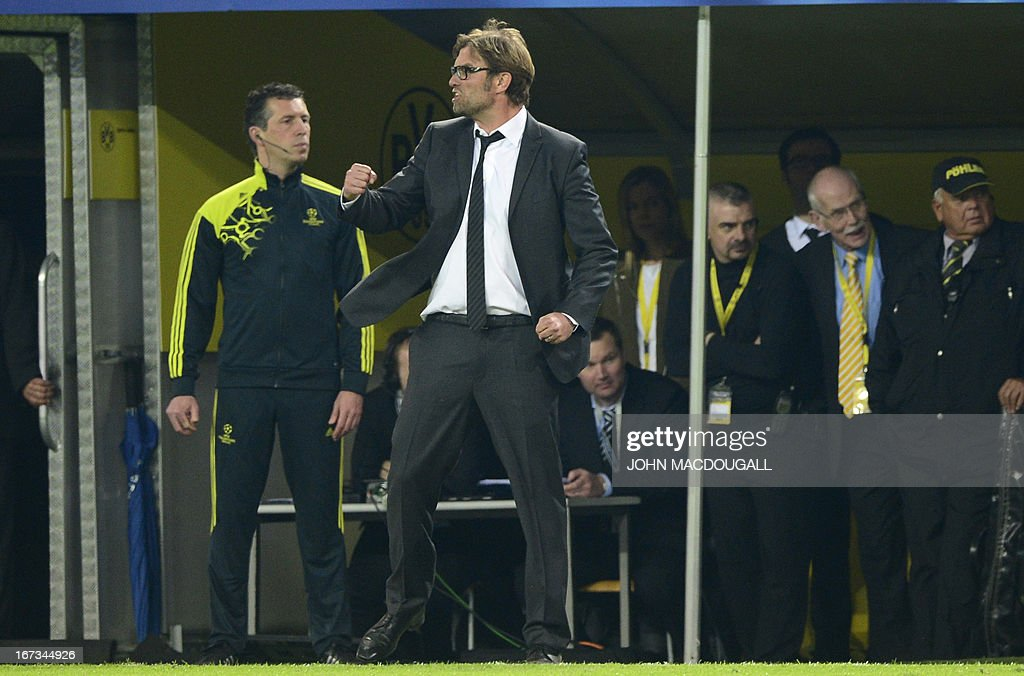 Dortmund's head coach Juergen Klopp (C) reacts during the UEFA Champions League semi final first leg football match between Borussia Dortmund and Real Madrid on April 24, 2013 in Dortmund, western Germany. AFP PHOTO / JOHN MACDOUGALL