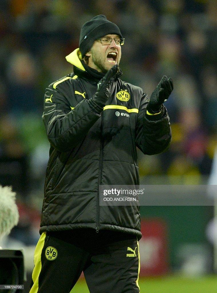 Dortmund's head coach Juergen Klopp reatcs during the German first division Bundesliga football match Werder Bremen vs Borussia Dortmund at the Weser stadium in Bremen on January 19, 2013.