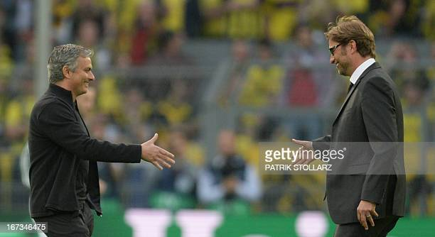 Dortmund's head coach Juergen Klopp shakes hands with Real Madrid's Portuguese coach Jose Mourinho prior to the UEFA Champions League semi final...