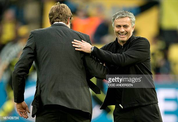 Dortmund's head coach Juergen Klopp share a joke with Real Madrid's Portuguese coach Jose Mourinho before the UEFA Champions League semi final first...