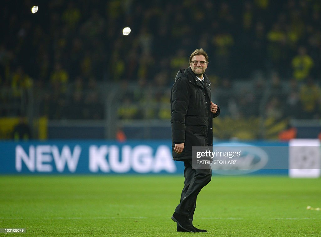 Dortmund's head coach Juergen Klopp smiles after the UEFA Champions League last 16, second leg match Borussia Dortmund vs Shakhtar Donetsk in Dortmund, western Germany, on March 5, 2013. Dortmund won the match 3-0.