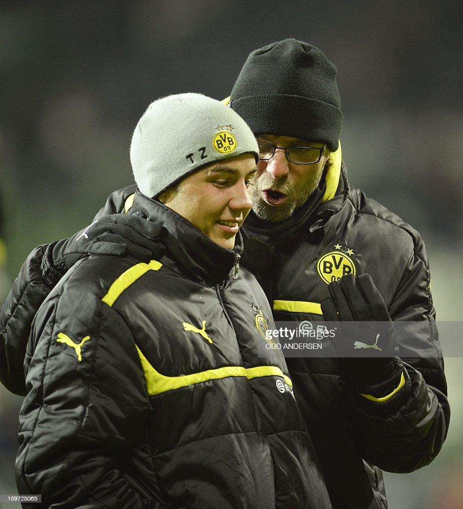 Dortmund's head coach Juergen Klopp (R) speaks to Dortmund's Mario Goetze after a 5-0 victory during the German first division Bundesliga football match Werder Bremen vs Borussia Dortmund at the Weser stadium in Bremen on January 19, 2013.