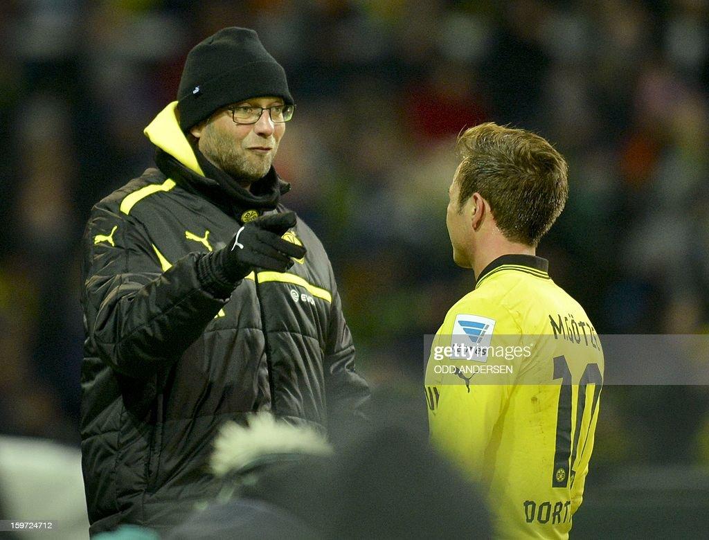 Dortmund's head coach Juergen Klopp (L) speaks with Dortmund's Mario Goetze during the German first division Bundesliga football match Werder Bremen vs Borussia Dortmund at the Weser stadium in Bremen on January 19, 2013.
