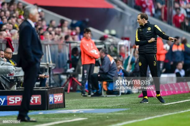 Dortmund's head coach Thomas Tuchel and Bayern Munich's Italian head coach Carlo Ancelotti stand on the sideline during the German first division...