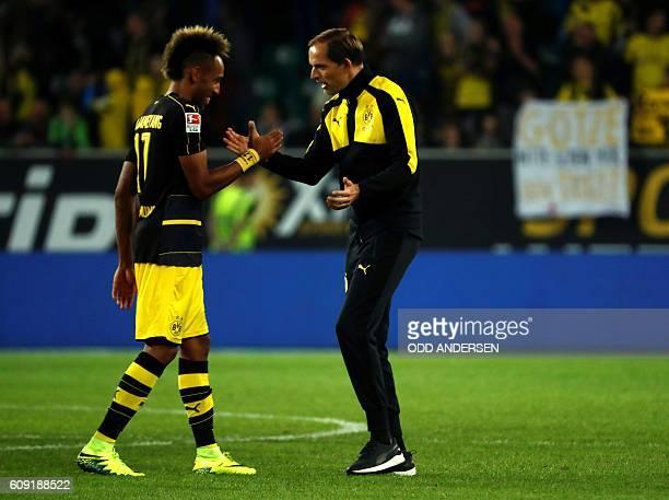 Dortmund's head coach Thomas Tuchel and Dortmund's Gabonese forward PierreEmerick Aubameyang celebrate after the German first division Bundesliga...