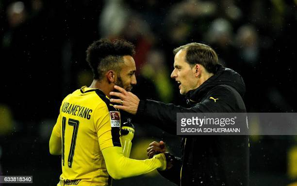 Dortmund's head coach Thomas Tuchel celebrates with Dortmund's Gabonese forward PierreEmerick Aubameyang after the German First division Bundesliga...