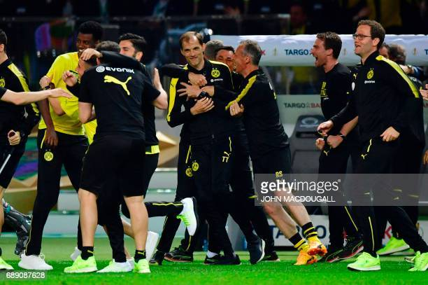 Dortmund's head coach Thomas Tuchel celebrates with team members after winning the German Cup final football match Eintracht Frankfurt v BVB Borussia...