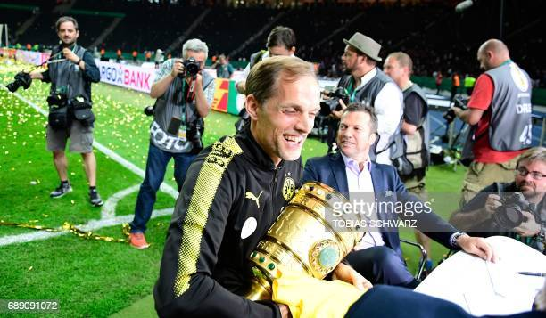 Dortmund's head coach Thomas Tuchel celebrates with the trophy after victory during the German Cup final football match Eintracht Frankfurt v BVB...