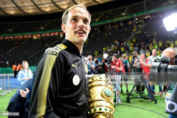 Dortmund's head coach Thomas Tuchel celebrates with the trophy after the German Cup final football match Eintracht Frankfurt v BVB Borussia Dortmund...