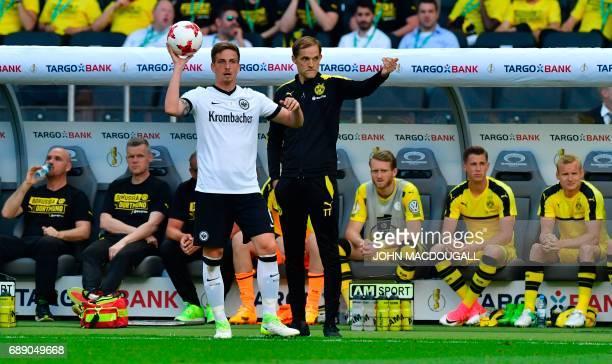 Dortmund's head coach Thomas Tuchel gestures next to Frankfurt's defender Bastian Oczipka during the German Cup final football match Eintracht...