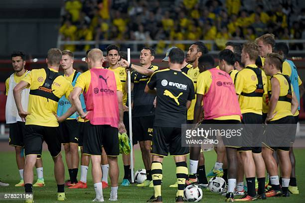 Dortmund's head coach Thomas Tuchel looks at his watch as he takes part in a training session with teammates ahead of the 2016 International...