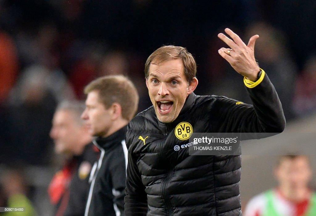 Dortmund's head coach Thomas Tuchel reacts as his team scored during the German Cup ( Pokal ) quarter final football match VfB Stuttgart v Borussia Dortmund on February 9, 2016 in Stuttgart. / AFP / Thomas Kienzle / AT +49 69 67880 /