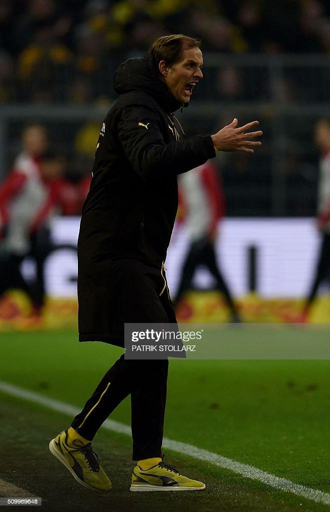 Dortmund's head coach Thomas Tuchel reacts during the German first division Bundesliga football match of Borussia Dortmund vs Hannover 96 in Dortmund, western Germany, on February 13, 2016. / AFP / PATRIK STOLLARZ /