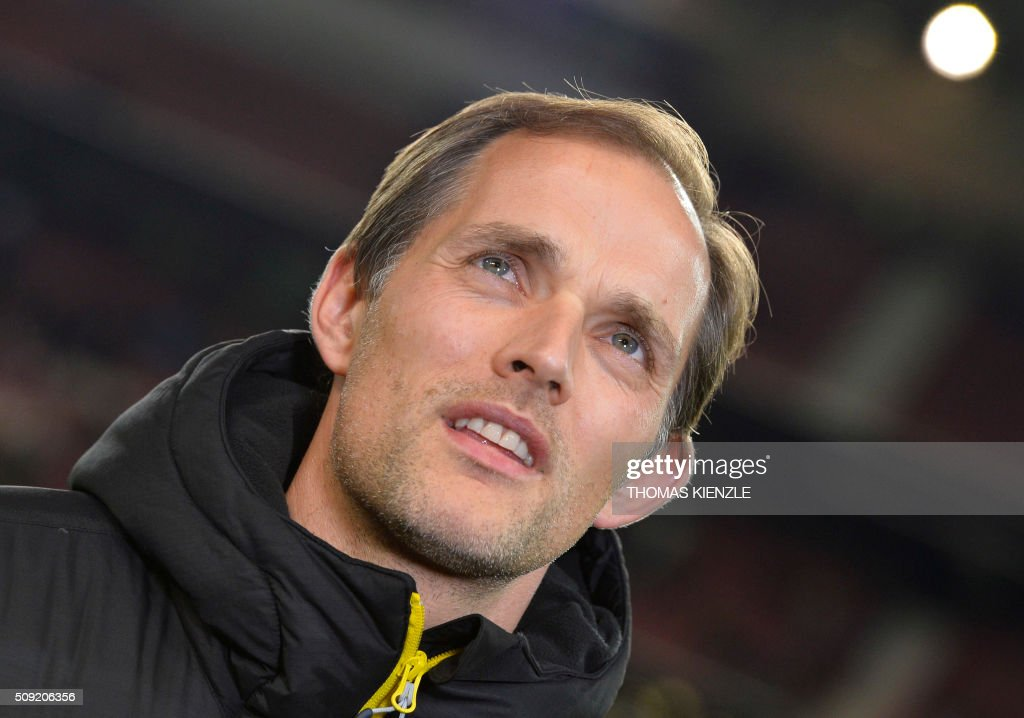 Dortmund's head coach Thomas Tuchel reacts prior to the German Cup ( Pokal ) quarter final football match VfB Stuttgart v Borussia Dortmund on February 9, 2016 in Stuttgart. / AFP / Thomas Kienzle / AT +49 69 67880 /