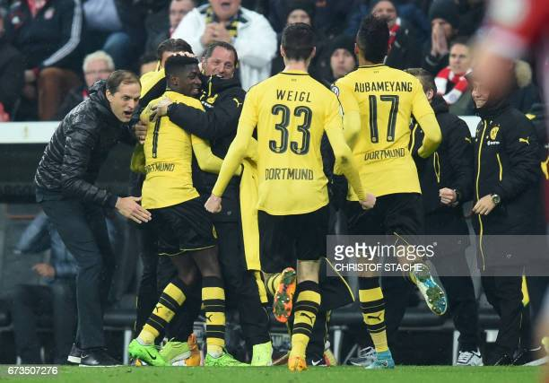 Dortmund's headcoach Thomas Tuchel Dortmund's French midfielder Ousmane Dembele and teammembers celebrate after the third goal during the German Cup...