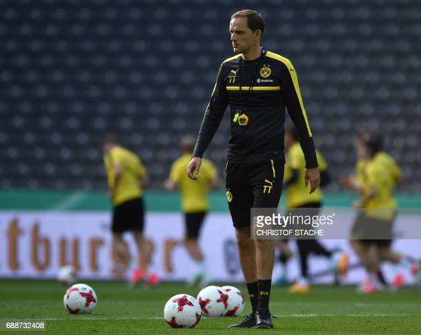 Dortmund's headcoach Thomas Tuchel oversees a training session on the eve of the German Cup football final match between Eintracht Frankfurt and BVB...