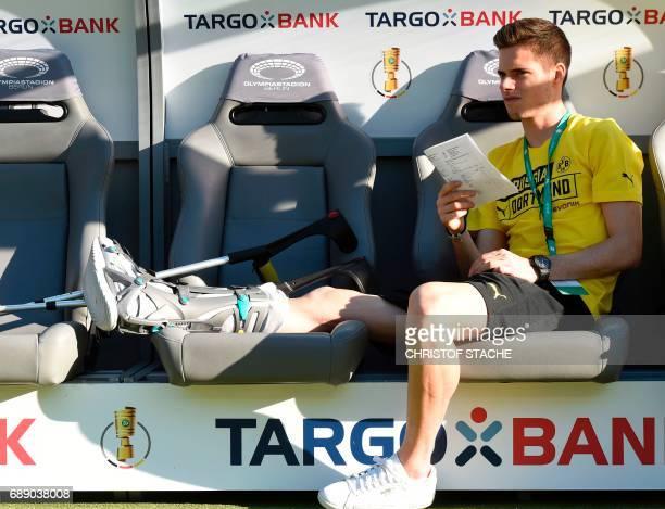 Dortmund's injured midfielder Julian Weigl sits on the bench prior to the German Cup final football match Eintracht Frankfurt v BVB Borussia Dortmund...