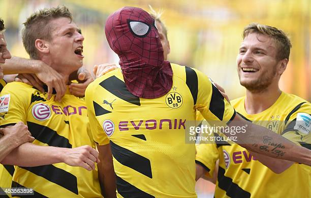Dortmund's Italian striker Circo Immobile Dortmund's Polish defender Lukasz Piszczek celebrate after Dortmund's Gabonese striker PierreEmerick...