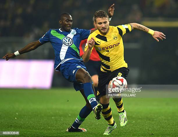 Dortmund's Italian striker Ciro Immobile and Wolfsburg´s defender Josuha Guilavogui vie for the ball during the German First division Bundesliga...