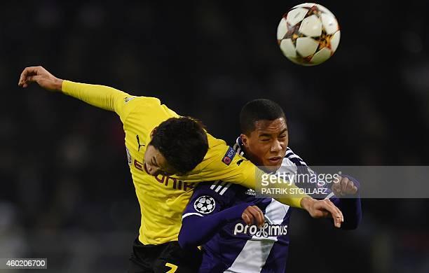 Dortmund's Japanese midfielder Shinji Kagawa and Anderlecht's midfielder Youri Tielemans vie for the ball during the second leg UEFA Champions League...