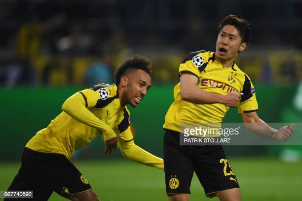 Dortmund's Japanese midfielder Shinji Kagawa and Dortmund's Gabonese forward PierreEmerick Aubameyang celebrate setting up their teammate Dortmund's...