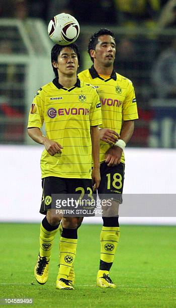 Dortmund's Japanese midfielder Shinji Kagawa and Dortmund's Turkish midfielder Nuri Sahin react to the 01 goal by Sevilla during the Europa League...