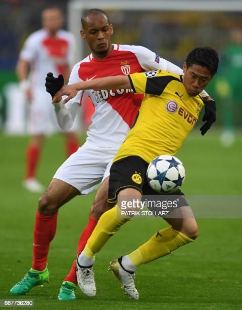 Dortmund's Japanese midfielder Shinji Kagawa and Monaco's Brazilian defender Fabinho vie for the ball during the UEFA Champions League 1st leg...