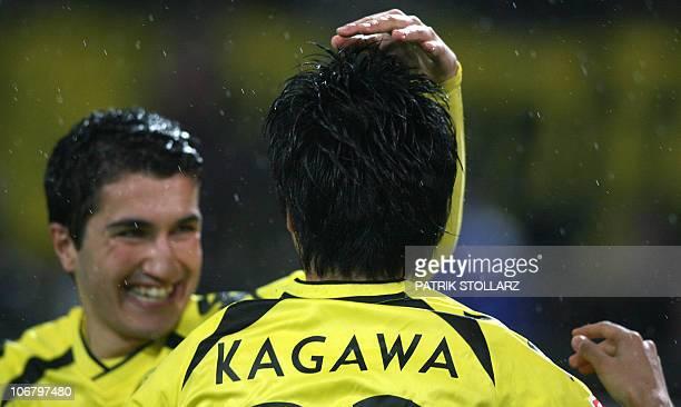 DFL Dortmund's Japanese midfielder Shinji Kagawa celebrates scoring with Dortmund's Turkish midfielder Nuri Sahin during the German first division...