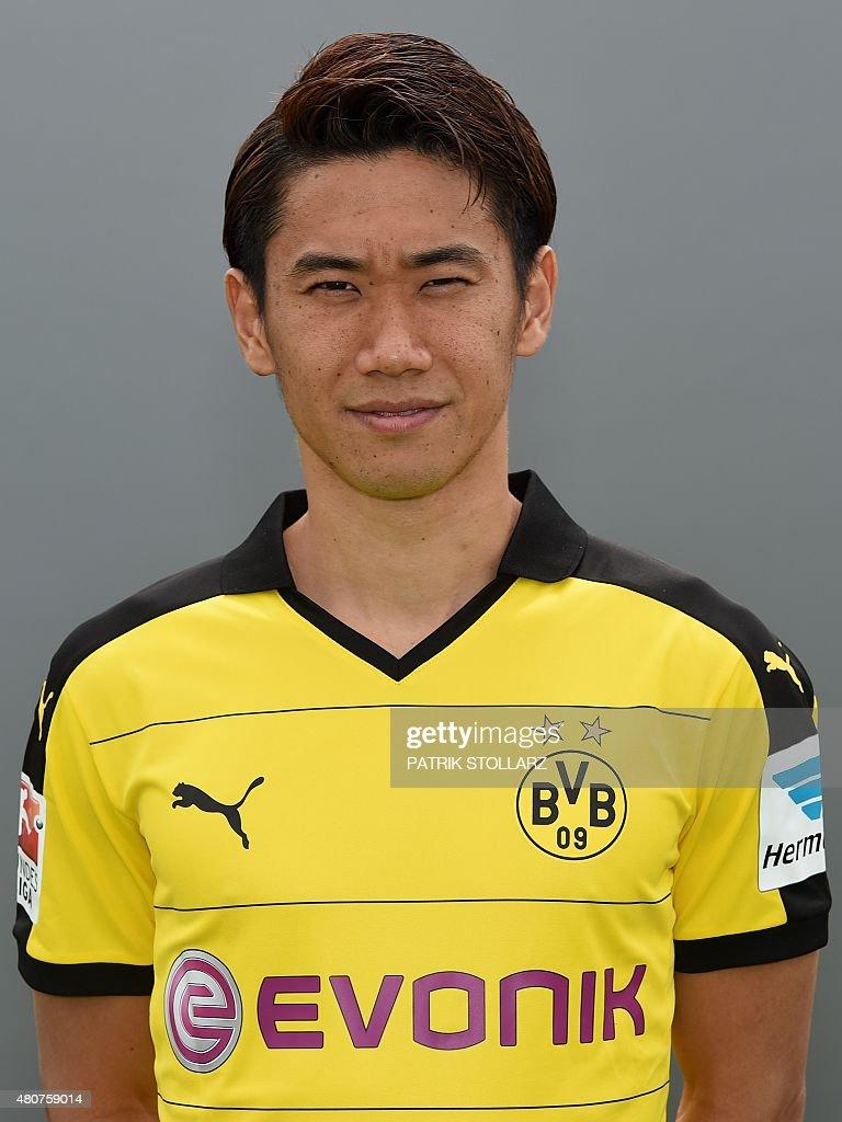 Dortmund s Japanese midfielder Shinji Kagawa poses during the team