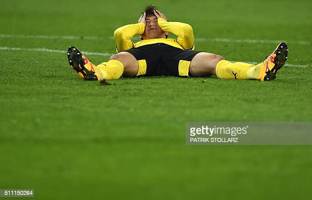 Dortmund's Japanese midfielder Shinji Kagawa reacts during the UEFA Europa League Round of 32 football match between Borussia Dortmund and FC Porto...