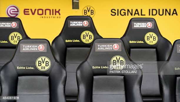 Dortmund's logo is displayed on the team's bench during the German first division Bundesliga football match Borussia Dortmund vs Bayer Leverkusen in...