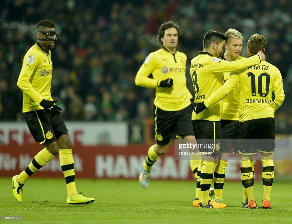 Dortmund's Marco Reus (2ndR) celebrates scoring during the German first division Bundesliga football match Werder Bremen vs Borussia Dortmund at the Weser stadium in Bremen on January 19, 2013. AFP PHOTO / ODD ANDERSEN