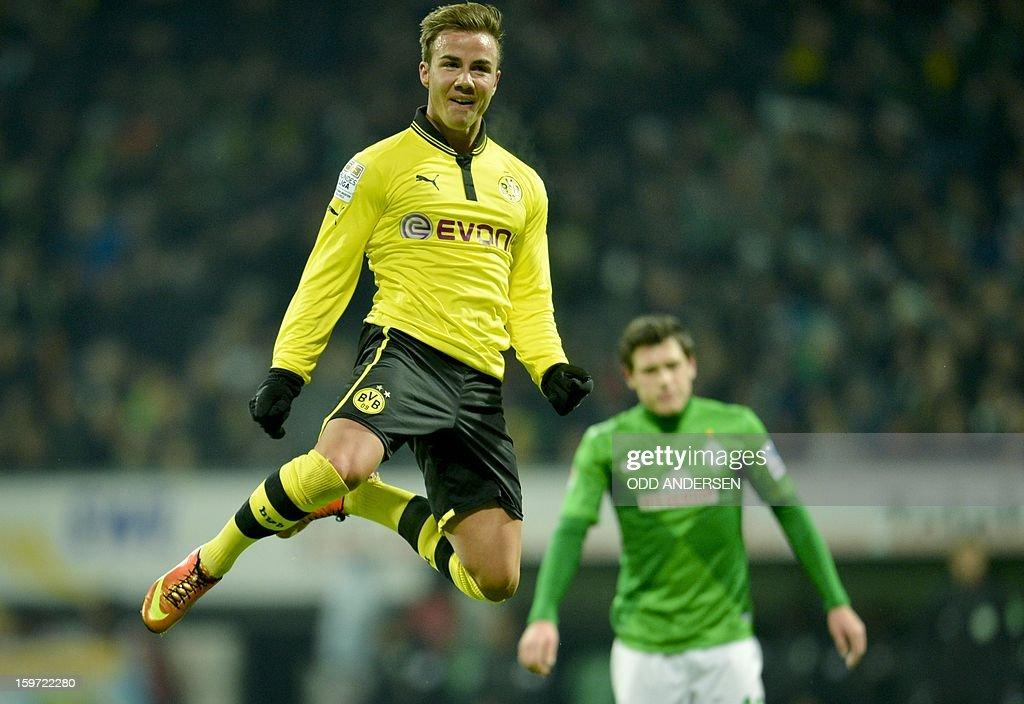 Dortmund's Mario Goetze celebrates putting his team 2-0 during the German first division Bundesliga football match Werder Bremen vs Borussia Dortmund at the Weser stadium in Bremen on January 19, 2013.