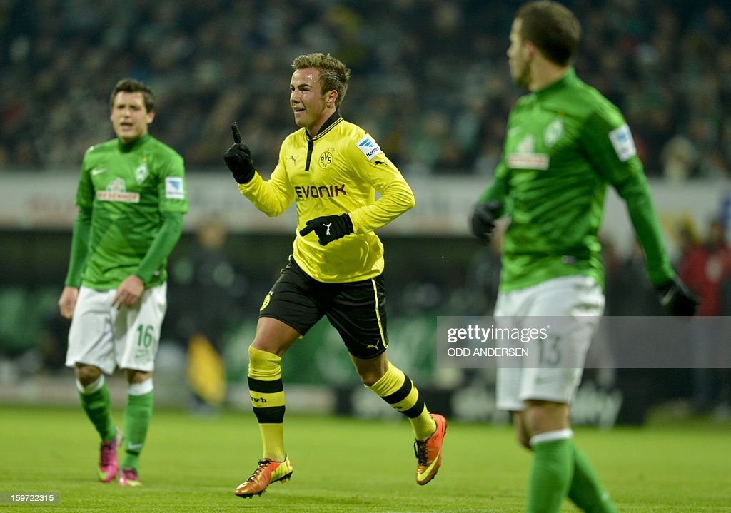 Dortmund's Mario Goetze (C) celebrates putting his team 2-0 during the German first division Bundesliga football match Werder Bremen vs Borussia Dortmund at the Weser stadium in Bremen on January 19, 2013.