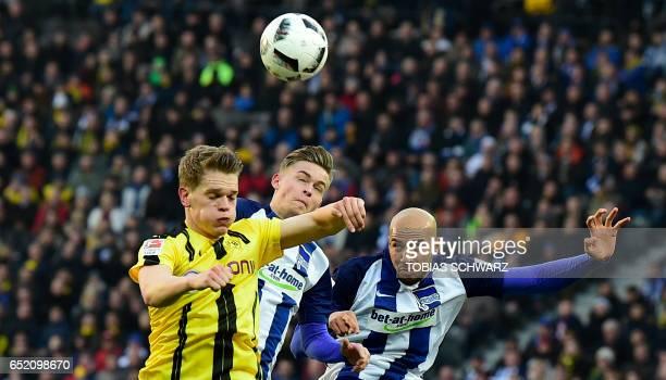 Dortmund's Matthias Ginter Hertha Berlin's defender Maximillian Mittelstaedt and Hertha Berlin's US defender John Anthony Brooks vie for the ball...