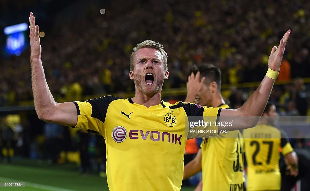 Dortmund's midfielder André Schuerrle celebrates during the UEFA Champions League first leg football match between Borussia Dortmund and Real Madrid at BVB stadium in Dortmund, on September 27, 2016. / AFP / PATRIK