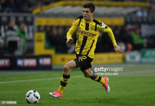 Dortmund's midfielder Christian Pulisic vies for the ball during the German first division Bundesliga football match of Borussia Moenchengladbach vs...