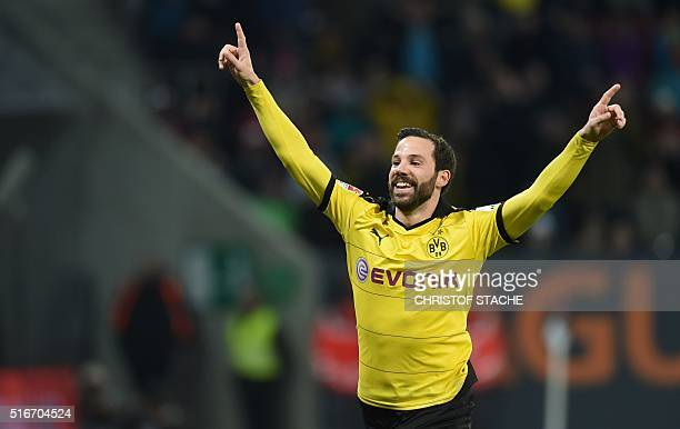 Dortmund's midfielder Gonzalo Castro celebrates after scoring during the German Bundesliga first division football match between FC Augsburg vs...