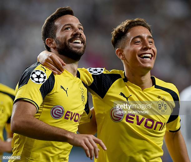 Dortmund's midfielder Gonzalo Castro celebrates scoring with Dortmund's Turkish midfielder Emre Mor during the UEFA Champions League group F football...