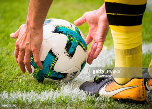 Dortmund's midfielder Gonzalo Castro places the ball for a corner kick during the German First division Bundesliga football match VfL Wolfsburg v BVB...