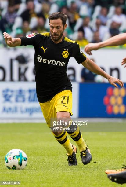 Dortmund's midfielder Gonzalo Castro runs with the ball during the German first division Bundesliga football match Wolfsburg v Dortmund at the...