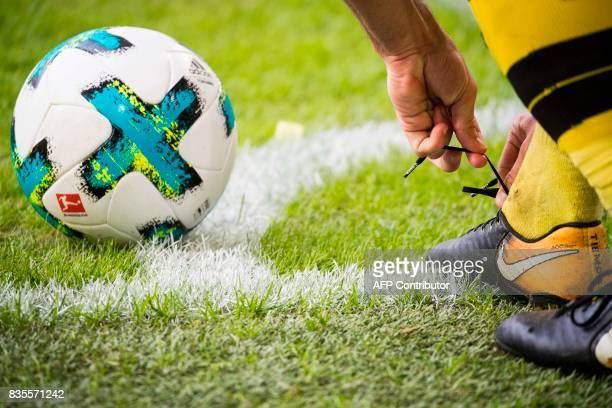 Dortmund's midfielder Gonzalo Castro ties his laces before taking a corner kick during the German First division Bundesliga football match VfL...