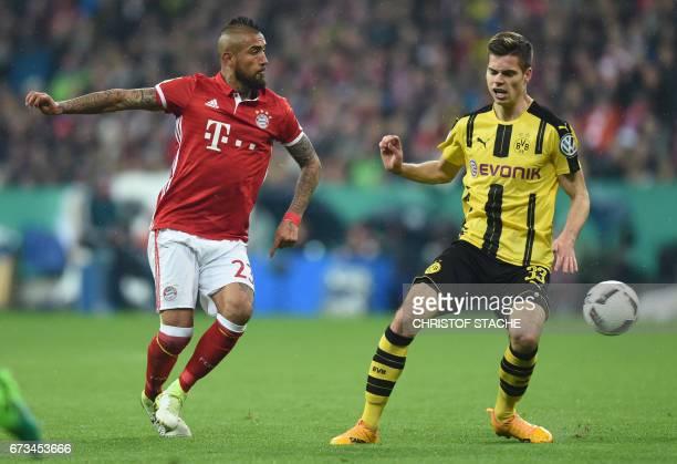 Dortmund's midfielder Julian Weigl and Bayern Munich's Chilian midfielder Arturo Vidal vie for the ball during the German Cup DFB Pokal semifinal...