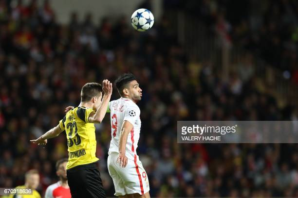 Dortmund's midfielder Julian Weigl and Monaco's Colombian forward Radamel Falcao go for a header during the UEFA Champions League 2nd leg...