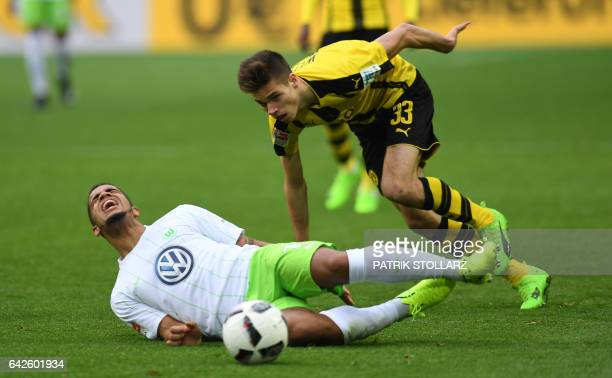 Dortmund's midfielder Julian Weigl and Wolfsburg's striker Daniel Didavi vie for the ball during the German First division Bundesliga football match...