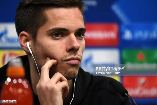 Dortmund's midfielder Julian Weigl attends a press conference on the eve of the Champion's League Group H football match Borussia Dortmund against...