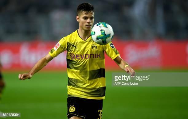 Dortmund's midfielder Julian Weigl plays ball during the German First division Bundesliga football match Borussia Dortmund vs Borussia...